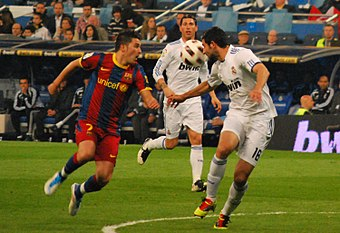 A 2011 Spanish La Liga match between Real Madrid and Barcelona. This fixture, known as El Clasico, is one of the most renowned in sport. David Villa in Clasico.jpg
