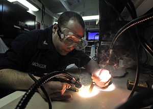 Defense.gov News Photo 110326-N-0569K-068 - Petty Officer 2nd Class Christopher M. Monger repairs circuit cards aboard the aircraft carrier USS Enterprise CVN 65 underway in the Arabian Sea.jpg