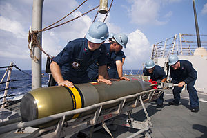 Defense.gov News Photo 110604-N-CB621-047 - U.S. Navy sailors aboard the guided missile destroyer USS Chung-Hoon DDG 93 load a Mark 46 torpedo into a launcher while underway in the Pacific.jpg
