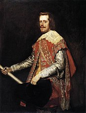 Portrait of the king of Spain, who has a long pale face and a curling moustache. He wears a scarlet coat richly embroidered in gold, and has a large collar trimmed with lace. He carries a black broad-brimmed hat. He stands as if he has just stopped for a moment.