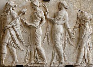 Horae - Dionysus leading the Horae (Neo-Attic Roman relief, 1st century)