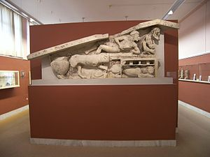 Korkyra (polis) - A relief of Dionysus Bacchus at the Archaeological Museum of Corfu. Pediment with Dionysos at the Corfu Museum. Left part of an Archaic pediment from the area of Figareto. It depicts a Dionysiac symposium. Dated to 500 B.C.