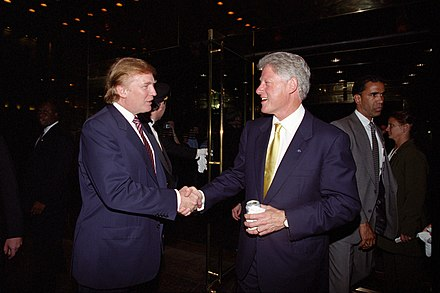 Future president Donald Trump and Clinton shaking hands at Trump Tower, June 2000 Donald Trump and Bill Clinton.jpg