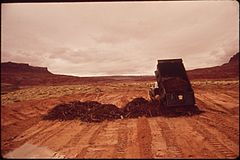 Dumping Oil Laden Debris; Part of EPA Supervised Clean - Up of the San Juan River Oil Spill, 10-1972 (3814973022).jpg