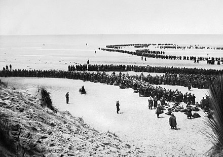 British troops line up on the beach at Dunkirk to await evacuation, 26–29 May 1940.