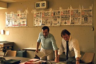 Editors work on producing an issue of Bild, West Berlin, 1977. Previous front pages are affixed to the wall behind them. Editorial office of Bild newspaper, West Berlin, 1977.jpg