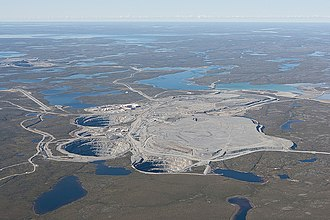 Ekati Diamond Mine - Ekati mine aerial view, August 2010. Four open pits on four kimberlite pipes may be seen, along with the Ekati airport.