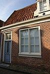 foto van Eenvoudige laat 18e-eeuwse woning onder dwarsdak