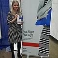 """Erin Miller with her book, """"Final Flight Final Fight"""".jpg"""