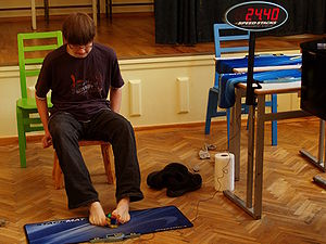 Speedcubing - Anssi Vanhala solving a 3×3×3 Rubik's Cube with his feet in 36.72 seconds, at the 2009 Estonian Open.