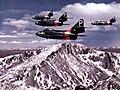 F9F-6 Cougars of NARTU Denver over Pikes Peak 1955.jpg