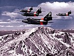 F9F-6 Cougars of NARTU Denver over Pikes Peak 1955.jpg
