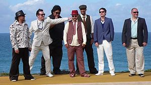 Fat Freddy's Drop - Fat Freddy's Drop during a European tour in 2008. Left to right: Tehimana Kerr, Joe Lindsey, Chris Faiumu, Iain Gordon, Dallas Tamaira, Toby Laing, and Scott Towers.