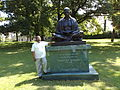 Father Felix Raj at the statue of Mahatma Gandhi in UN garden Geneva.jpg