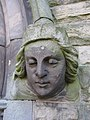 Female stone head on Christ Church west doorway - geograph.org.uk - 1546852.jpg