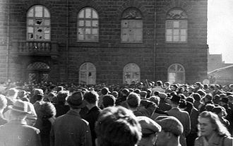 1949 anti-NATO riot in Iceland - Fighting breaks out between anti- and pro-NATO supporters, and police. The windows of the House of the Althing have been smashed. 30 March 1949.