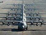 Five U.S. Air Force C-130 Hercules cargo aircraft line up before taking off during readiness week at Yokota Air Base, Japan, on Feb 130221-F-WE773-983.jpg