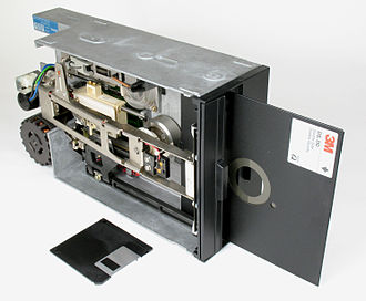 History of the floppy disk - 8-inch disk drive with diskette (3½-inch disk for comparison)