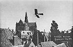 Fokker vliegt rond de Grote of Sint-Bavokerk in Haarlem.jpg