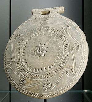 "Frying pans - ""Frying pan"" with running spiral decoration, Early Cycladic I–II (ca. 2700 BC). From Syros?"