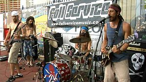 """Full Service (band) - Playing on a sidewalk during a """"takeover"""""""