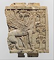 Furniture plaque carved in relief with a griffin in a floral landscape MET DP110706.jpg