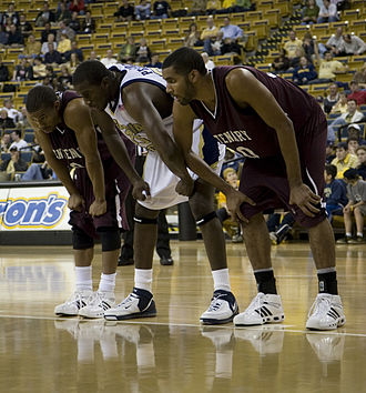 Free throw - Players waiting on the side during a free throw at a Georgia Tech Yellow Jackets vs. Centenary Gentlemen college basketball game.