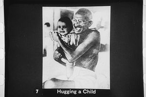 Gandhi hugging a child.
