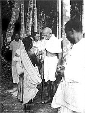 Noakhali riots - Gandhi listens to a survivor in Noakhali, 1946