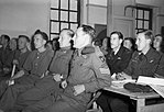 Glider pilots of 6th Airborne Division and RAF crews are briefed at RAF Harwell for the D-Day invasion, 5 June 1944. H39062.jpg