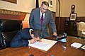 Gov Paterson signs Chapter 294 of the Laws of 2010 on 7.30.10 as Assemblyman Castelli looks on in Red Room in Albany.JPG
