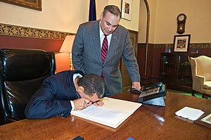 Robert Castelli - Former Governor of New York David Paterson signs Chapter 294 of the laws of 2010 in the Red Room of the State Capitol in Albany, the first law authored by Castelli, then a freshman legislator.