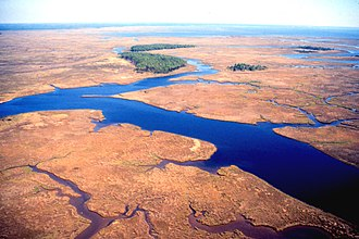 Grand Bay National Wildlife Refuge - East over Bayou Cumbest looking east showing maritime pine islands on Crooked Bayou