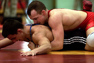 Greco-Roman wrestling - Even on the mat, a Greco-Roman wrestler must still find ways to turn his opponent's shoulders to the mat for a fall without using the legs.