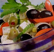 Greek salad. Feta cheese, a traditional ingredient, is usually sliced in small cubic pieces.