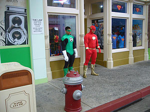Flash and Green Lantern stand around outside t...