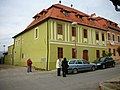 Green building with orange roof, Levoča (October 2006).jpg
