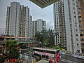 HK 上水 Sheung Shui 彩園邨 Choi Yuen Estate 彩園路 Choi Yuen Road MTR footbridge Feb-2014 view from MTR Station rainy day.JPG