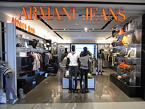 Designer clothing - Customers shopping at the Armani Jeans store in the Hong Kong Central IFC Mall. 2012.