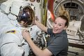 ISS-48 Kate Rubins prepares her spacesuit inside the Quest airlock.jpg