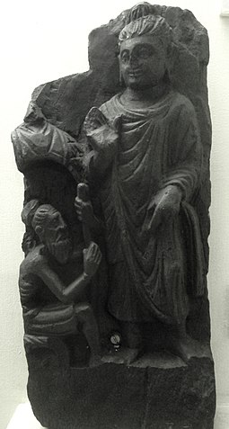 Buddha meets a Brahmin, at the Indian Museum, Kolkata Indian Museum Sculpture - Buddha meets a Brahmin (9218121775).jpg