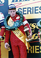 Indy Car Driver Mark Smith on the podium after a Formula Pacific race in New Zealand.jpg