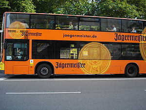 Out-of-home advertising - Vinyl decals allowing use of windows, on a side and rear advertisement for alcohol on a Berlin bus