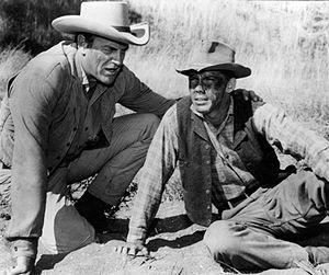 Chato (Apache) - James Arness as Matt Dillon (left).