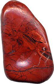 Polished jasper pebble, one inch (2.5 cm) long.