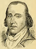 A man with dark, receding hair wearing a high collared white shirt and black jacket
