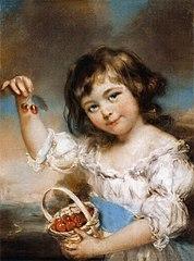 Petite fille tenant des cerises