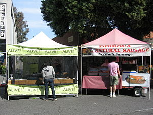 English: Two booths at Farmers market in Sunny...