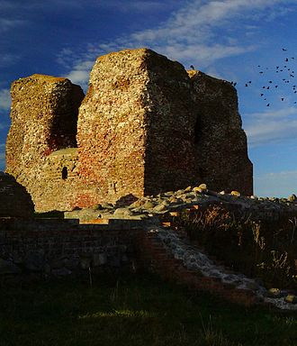 Karlsladen - The oak timber that Karlsladen was built from may have come fra a barn by Kalø Castle - here seen as a ruin. The castle, located on a peninsula in Aarhus Bay, down from the town Rønde, was abandoned in 1660.
