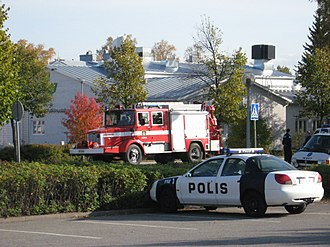 Kauhajoki school shooting - A fire engine and police cars outside the school.